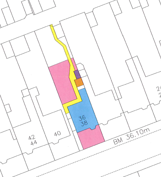 A plot with several references on the cadastral map in four different colours.