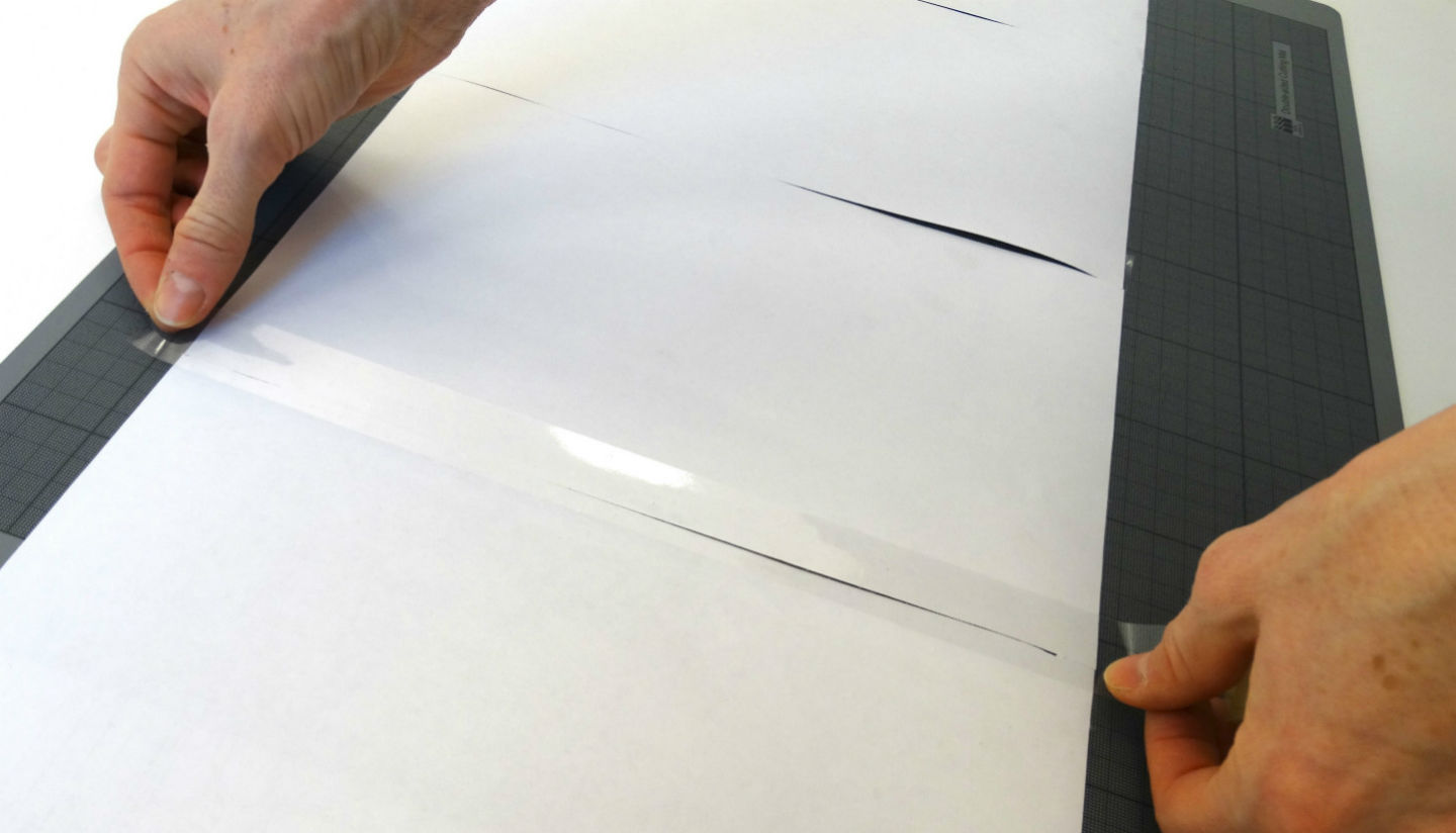 Taping sheets of a large title plan